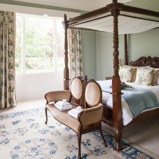 The romantic four poster in the bridal suite at Bressingham Hall