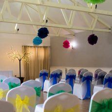 A multi coloured ceremony in the Dairy Barn